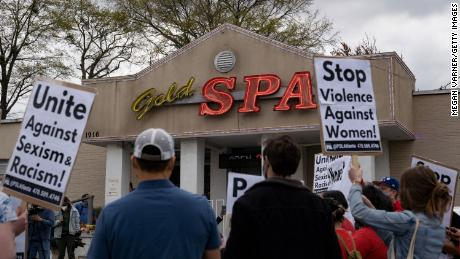 ATLANTA, GA - MARCH 18: Activists demonstrate outside Gold Spa following Tuesday night's shooting where three women were gunned down on March 18, 2021 in Atlanta, Georgia. Suspect Robert Aaron Long, 21, was arrested after a series of shootings at three Atlanta-area spas left eight people dead, including six Asian women. (Photo by Megan Varner/Getty Images)