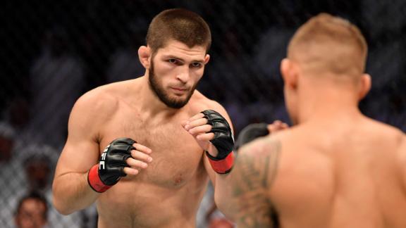 Nurmagomedov battles Dustin Poirier in their lightweight championship bout during UFC 242.