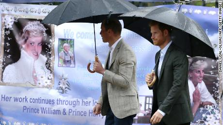 William, left, and Harry look at tributes left outside Kensington Palace to mark the 20th anniversary of Diana's death in 2017.