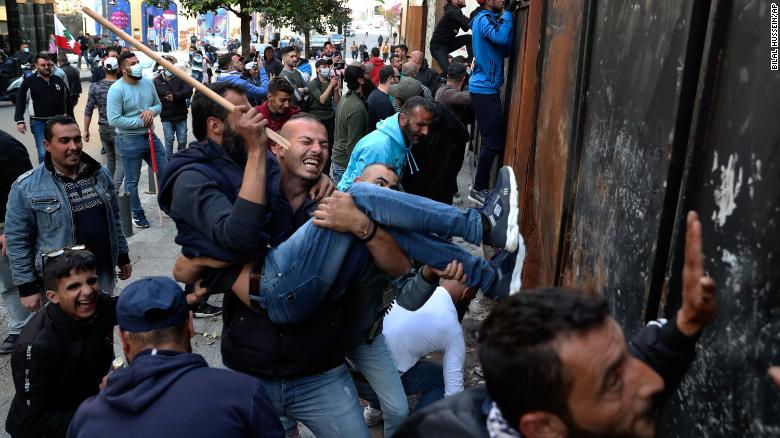 Specter of civil conflict in Lebanon looms as economic meltdown gives way to violence