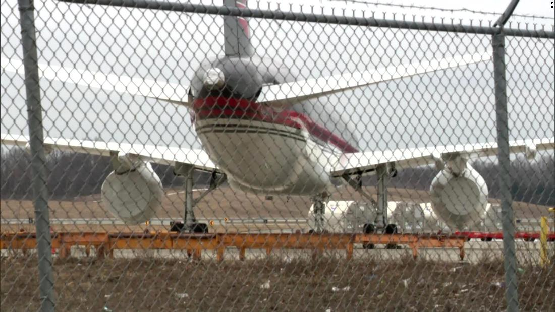 Trump's 757 is seen at Stewart Airport in New York in March 2021. The right engine wrapped in plastic, while the left engine appears to be removed.