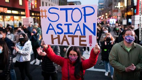 Protesters rally against Asian American discrimination and remember the lives lost in the Atlanta shootings, in Chinatown, Washington, DC, March 17. Six women of Asian heritage lost their lives.