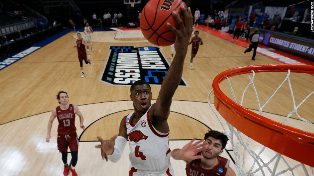 Arkansas' Davonte Davis rises for a layup during the Razorbacks' first-round win over Colgate.