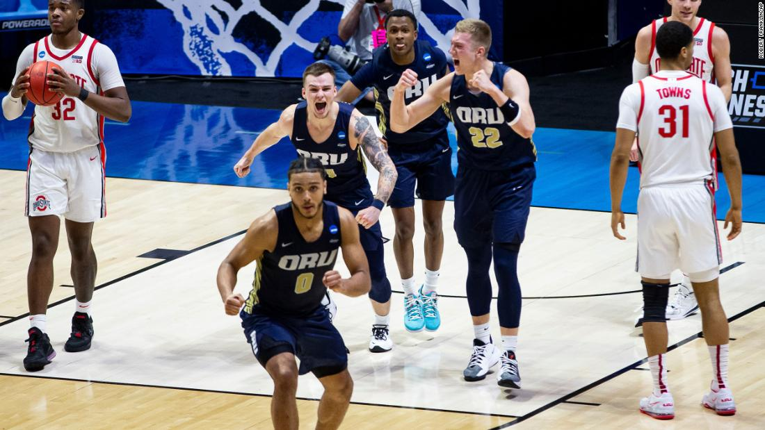 Players from Oral Roberts celebrate after their upset win over Ohio State on March 19. The Golden Eagles won 75-72 in overtime. It's only the ninth time in tournament history that a 15-seed has defeated a 2-seed.