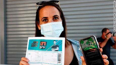 """A concertgoer presents her """"green pass"""" upon arrival at a Tel Aviv show."""