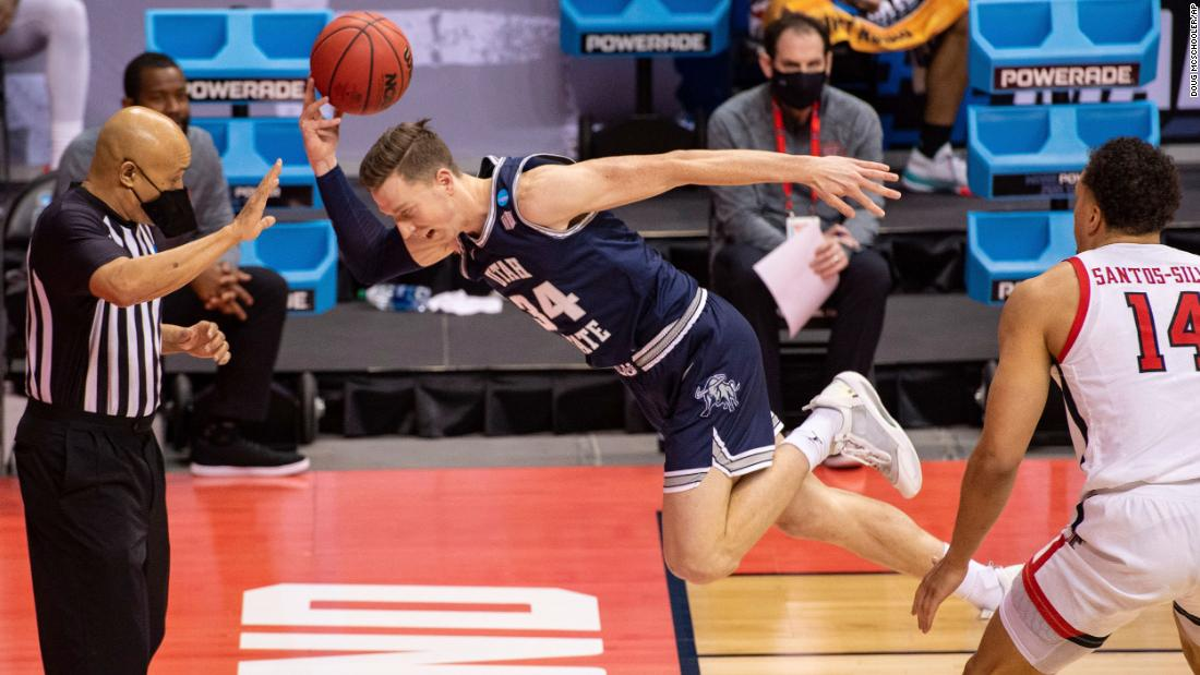 Utah State forward Justin Bean tries to save a ball from going out of bounds during a first-round game against Texas Tech.