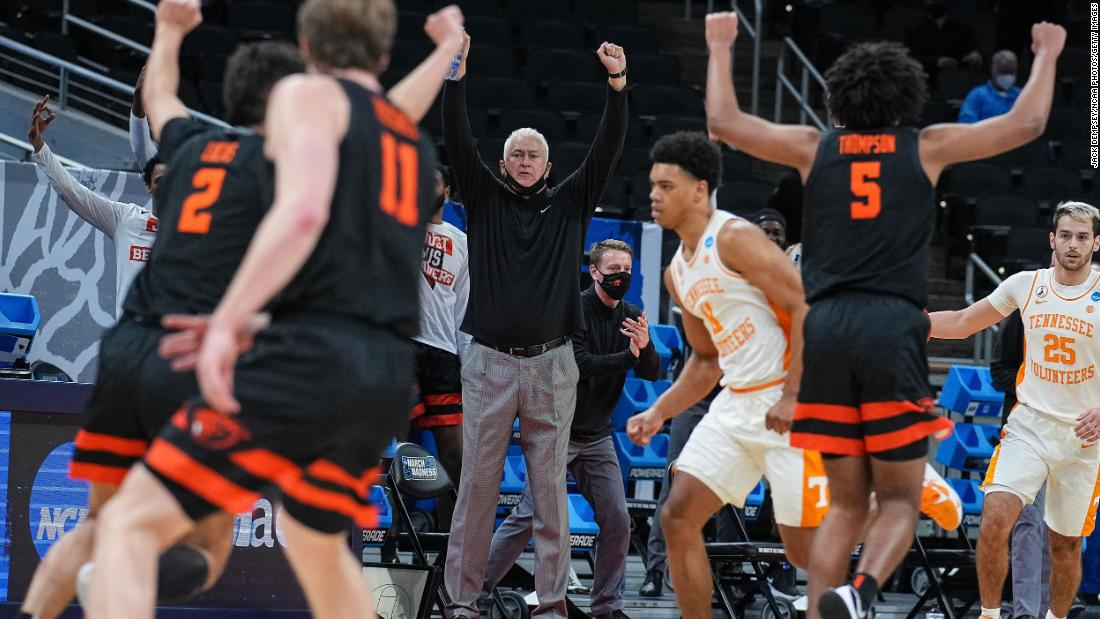 Oregon State head coach Wayne Tinkle celebrates a 3-pointer with his players during their upset win over Tennessee on March 19. The 12th-seeded Beavers defeated the fifth-seeded Volunteers 70-56.