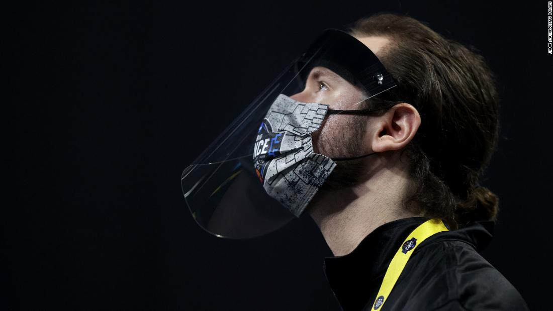 A man wears a face shield and mask at the North Texas-Purdue game.