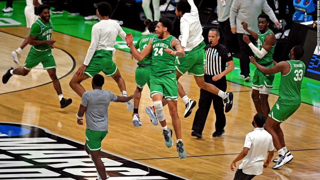 North Texas players celebrate after they upset Purdue on March 19. The Mean Green, a 13-seed, won 78-69 in overtime.