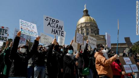 """People attend a """"Stop Asian Hate"""" rally next to the Georgia Capitol in Atlanta on Saturday, March 20."""