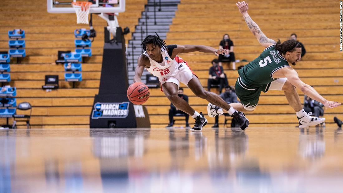 Houston's Tramon Mark dribbles past Cleveland State's Tre Gomillion during their first-round game on March 19.