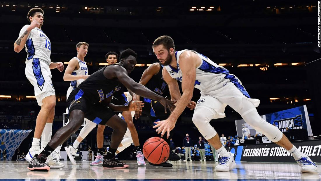 Creighton's Mitch Ballock, right, and UC-Santa Barbara's Amadou Sow reach for a loose ball during their first-round game.