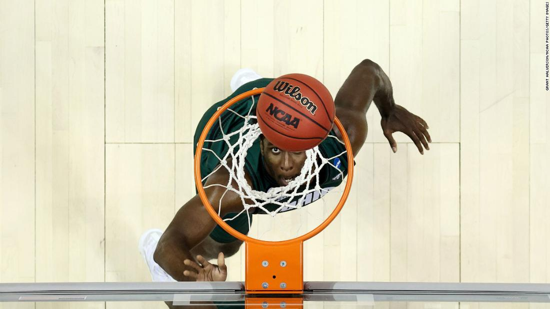 Ohio's Dwight Wilson III watches his layup fall through the net during the Virginia game.