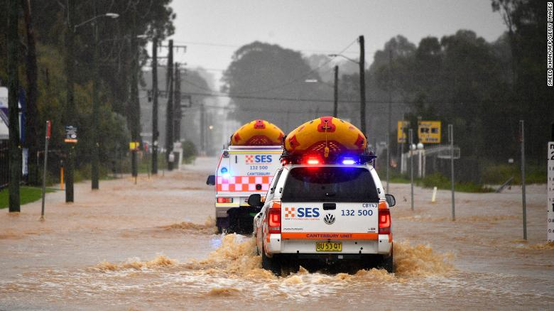 Emergency rescue vehicles drive through flooded parts of western Sydney, Australia, on March 20.