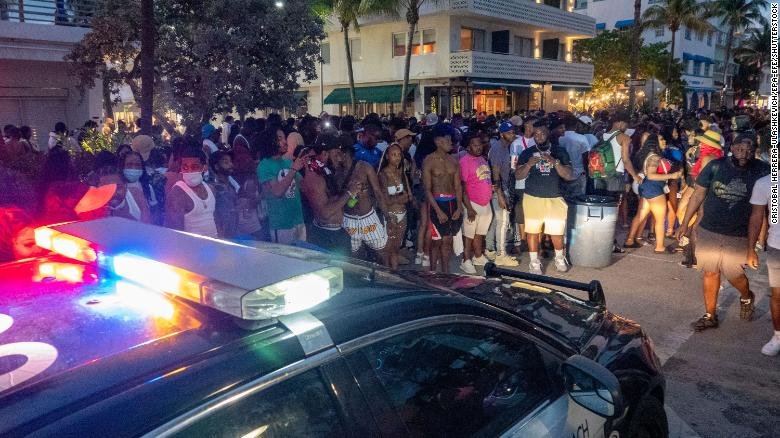 Miami Beach Police Department officers enforce an 8 p.m. curfew during spring break in Miami Beach, Florida, on March 20, 2021.