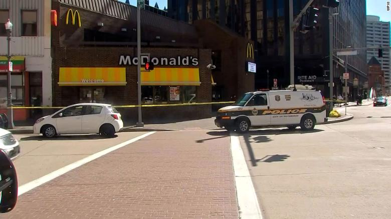 A 12-year-old and his family were waiting in line at McDonald's when a man stabbed the boy in the neck, police say