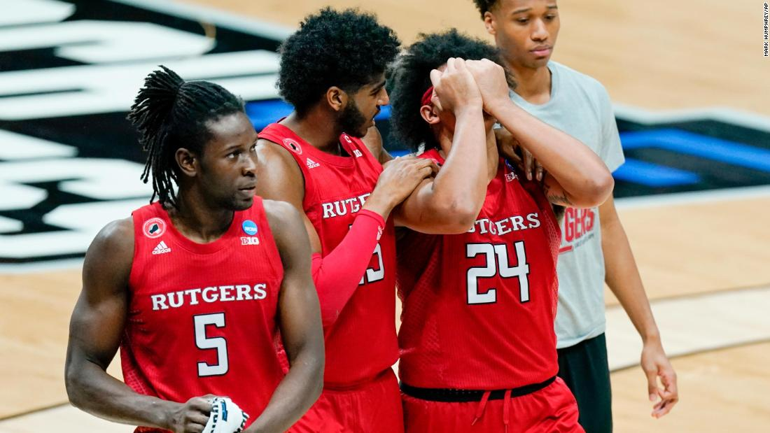 Rutgers' Myles Johnson consoles Ron Harper Jr. after the close loss to Houston.