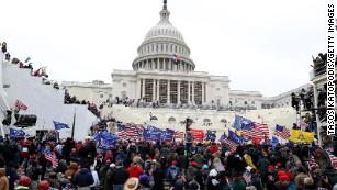 Judge rebukes GOP for downplaying US Capitol riot as he hands out first sentence in insurrection