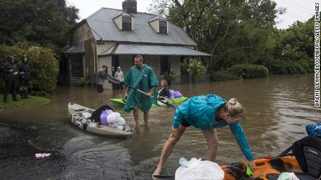 Residents unload household items from kayaks on a flooded street in Windsor, New South Wales, Australia on March 22nd.