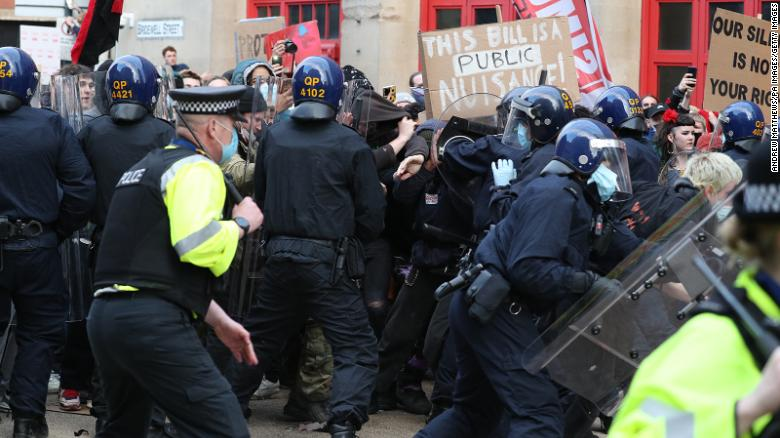Protesters and police clash during the event.