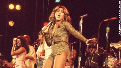 "Tina Turner (center) performs in the 1970s, as shown in the HBO documentary ""Tina."""