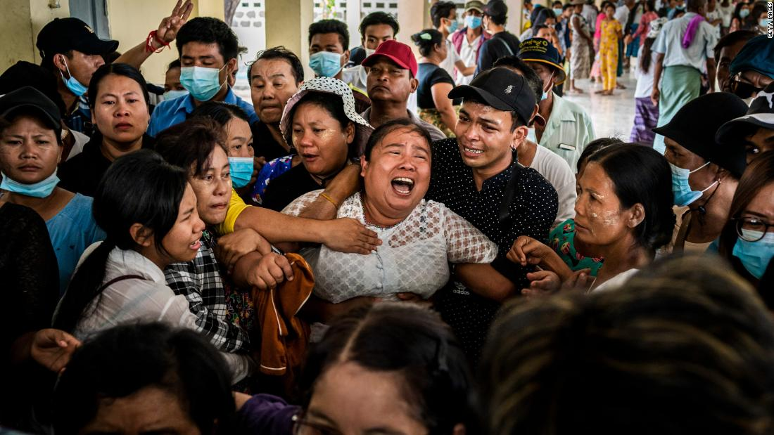 The mother of Aung Kaung Htet wails during the teenage boy's funeral on Sunday, March 21. Aung, 15, was killed when military junta forces opened fire on anti-coup protesters in Yangon, Myanmar.