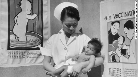 Nurse Minnie Sun holds a baby in 1933 at San Francisco's Chinese Hospital, the first Chinese-American health care in the continental US.
