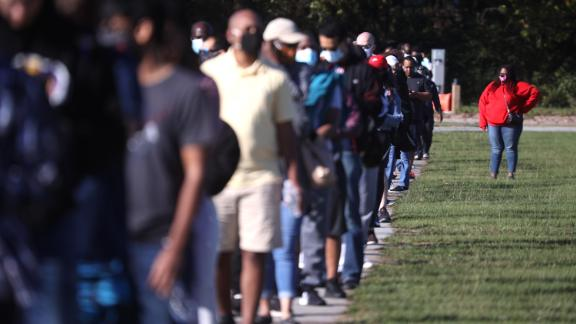 In this October 30, 2020, file photo, people line up to vote at the Gwinnett County Fairgrounds in Lawrenceville, Georgia. Hundreds of people lined up for about an hour on the final day of early voting in the state.