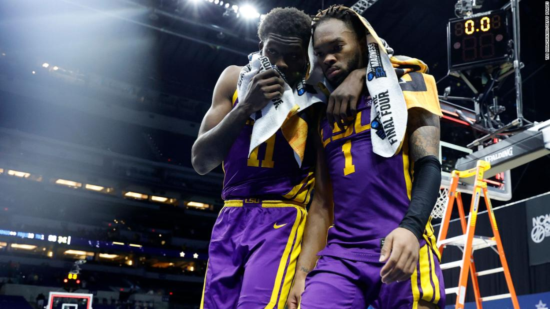LSU players Josh LeBlanc Sr., left, and Javonte Smart walk off the court after their second-round loss to Michigan.