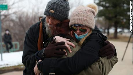 Sarah Moonshadow is comforted by David and Maggie Talley after Moonshadow was inside King Soopers grocery store.
