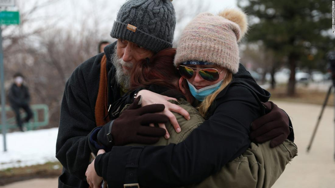 Sarah Moonshadow is comforted by David and Maggie Prowell after the shooting. Moonshadow was inside the store during the shooting.