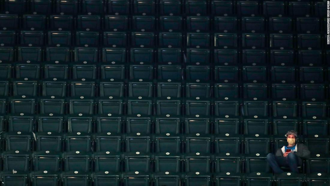 A fan sits in the stands during a second-round game in Indianapolis.