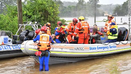 A family of four is evacuated from a flooded property at Upper Colo in north western Sydney, New South Wales on March 23.