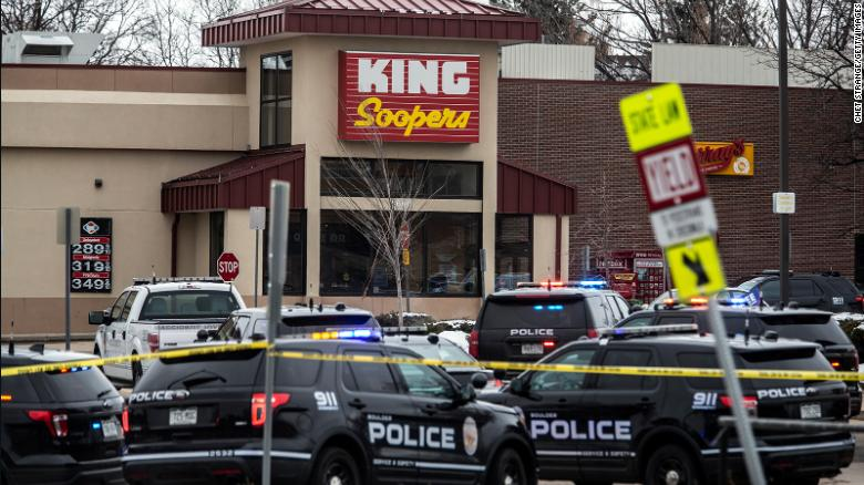 Police respond to the King Soopers grocery store in Boulder after a gunman opened fire Monday.