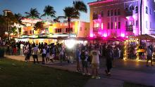 People enjoy themselves as they walk along Ocean Drive on March 18, 2021 in Miami Beach, Florida