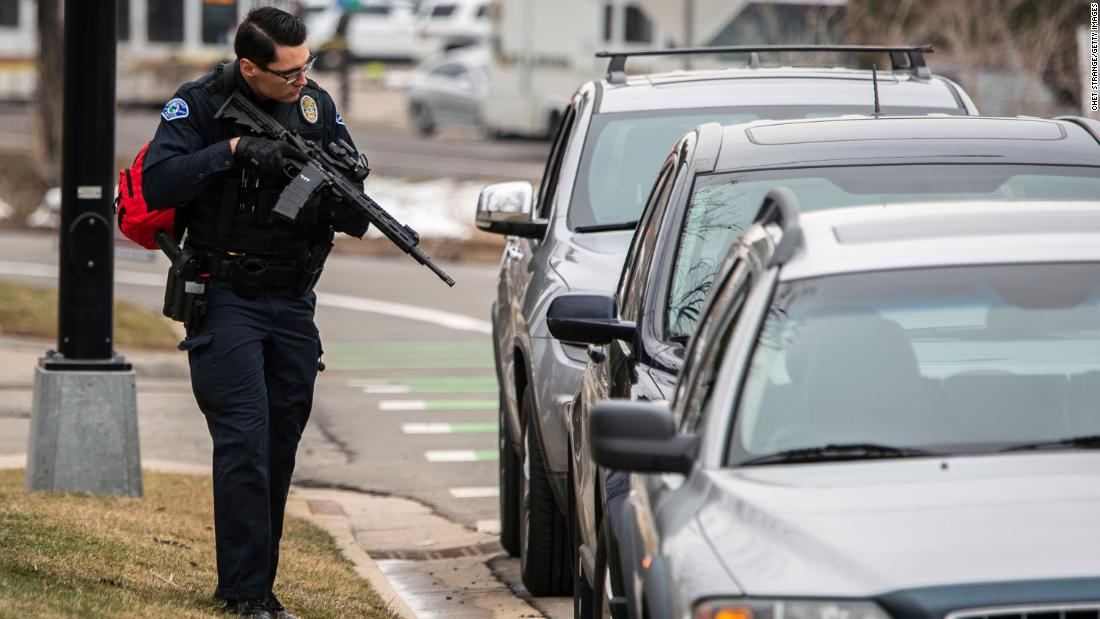 A police officer checks cars in the area.