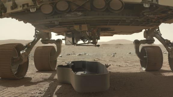 This image shows a debris shield, which protected the Ingenuity helicopter during landing. The helicopter can still be seen attached underneath the rover.