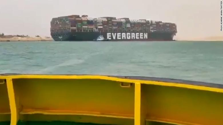 Container ship runs aground in Suez Canal causing traffic jam