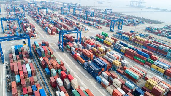 NANTONG, CHINA - MARCH 13, 2021 - A large machine lifts goods to a cargo ship at a container terminal in Nantong, east China's Jiangsu Province, March 13, 2021. In February, the cargo throughput of Nantong Port reached 18.453 million tons, up 17.6% year on year. PHOTOGRAPH BY Costfoto / Barcroft Studios / Future Publishing (Photo credit should read Costfoto/Barcroft Media via Getty Images)