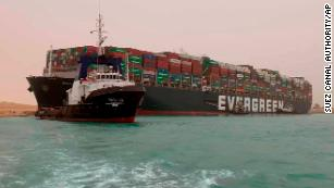 A huge ship is blocking a vital trade artery. It could get costly