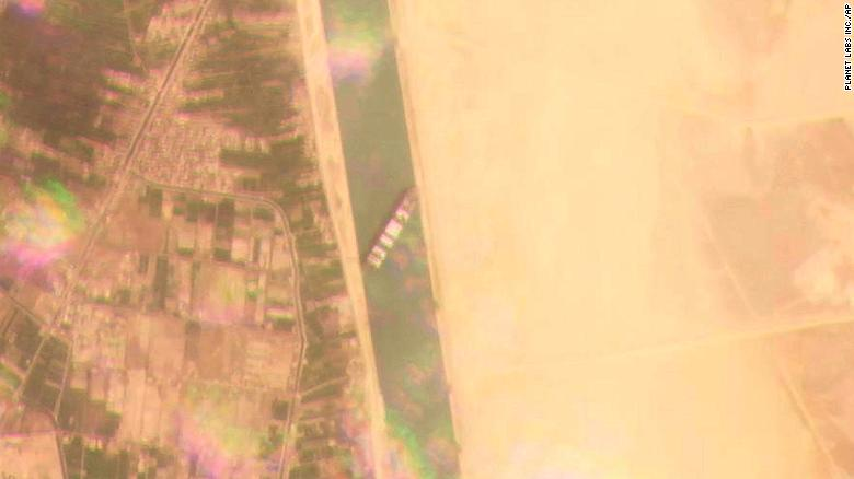 This satellite image from Planet Labs Inc. shows the cargo ship lodged across the waterway.