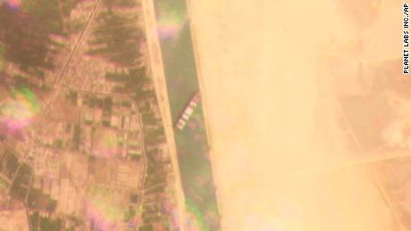 This satellite image from Planet Labs Inc. shows the Ever Given stuck in the Suez Canal on Tuesday.