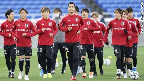 Members of Japan's national football team train in Yokohama.