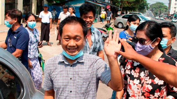 Thein Zaw, a journalist with the Associated Press, waves after being released from a prison in Yangon on March 24. He had been detained while covering an anti-coup protest in February.