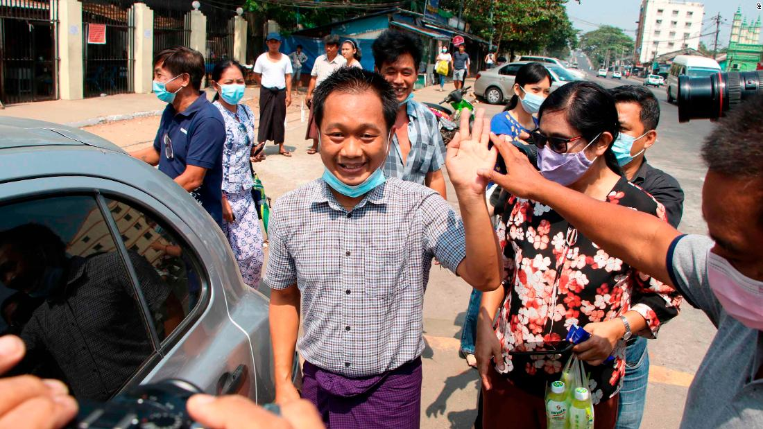 "Thein Zaw, a journalist with the Associated Press, waves after being <a href=""https://www.cnn.com/2021/03/24/media/ap-journalist-myanmar/index.html"" target=""_blank"">released from a prison</a> in Yangon on March 24. He had been detained while covering an anti-coup protest in February."