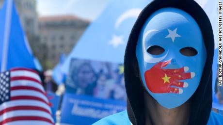 A demonstrator, wearing a mask, takes part in a protest against Chinas human rights abuses against Uighur Muslims in Xinjiang province, calling on U.S. government to take action against Beijing, on April 06, 2019 in Washington, United States. (Photo by Yasin Ozturk/Anadolu Agency/Getty Images)