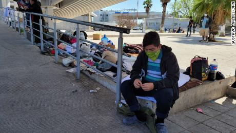Deported migrants gathered under a bridge at the border, but were later ordered to leave by authorities.