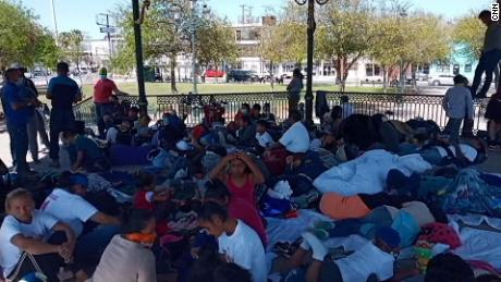 A gazebo in Reynosa, Mexico, is packed with migrants after authorities ordered them away from a bridge by the border.