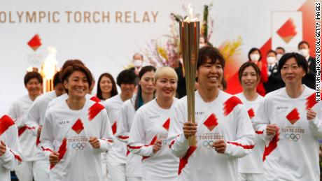 The Olympic flame starts its final leg to Tokyo. Some suggest this day should never have come