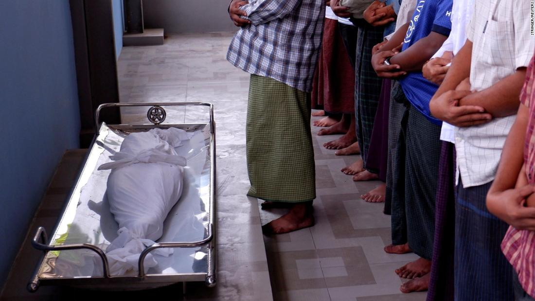 "Men pray during the funeral of Khin Myo Chit, a 7-year-old girl <a href=""https://www.cnn.com/2021/03/24/asia/myanmar-protests-7-year-old-killed-intl-hnk/index.html"" target=""_blank"">who was shot in her home</a> by Myanmar's security forces on March 23. The girl was killed during a military raid, according to the Reuters news agency and the advocacy group Assistance Association for Political Prisoners."